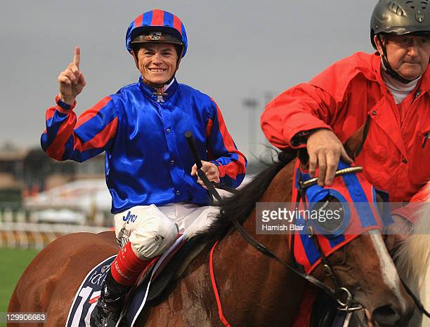Craig Williams celebrates as he returns to scale after riding Pinker Pinker to win race 8 the Tatts Cox Plate during Cox Plate Day at Moonee Valley...