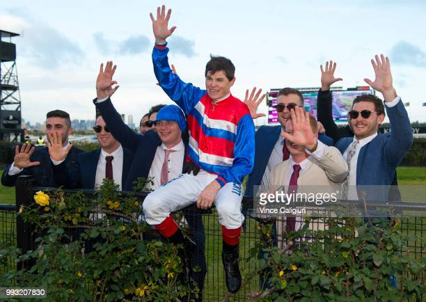 Craig Williams celebrates with racegoers after he rode win number five with Magic Consol in Race 8 VRCCRV Winter Championship Series Final during...