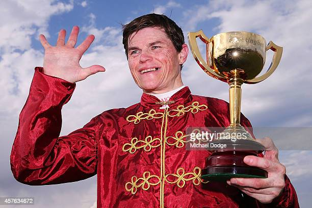 Craig Williams gestures with the cup after winning on Caravan Rolls On in race 7 the Sportingbet Powered By William Hill Geelong Cup the fifth time...