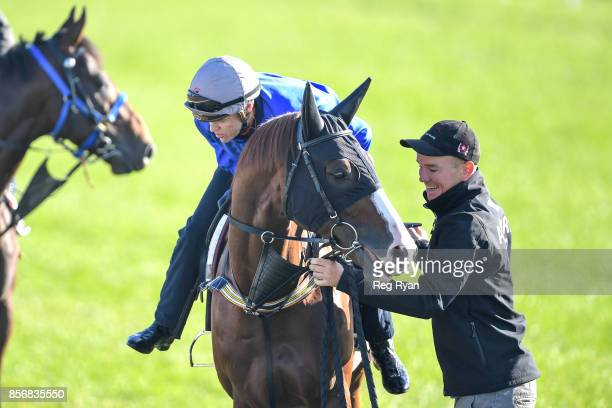 Craig Williams gets a helping hand from Strapper Matt Scown on Admire Deus at Werribee Racecourse on October 03 2017 in Werribee Australia