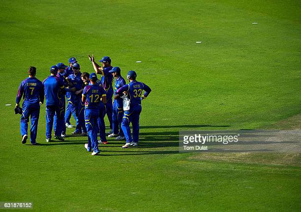 Craig Williams of Namibia celebrates with his team taking the wicket of Paul Stirling of Ireland during the Desert T20 Challenge match between...