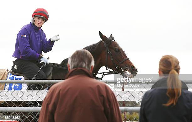 Craig Williams on Mount Athos speaks to trainer Luca Cumani and Francesca Cumani after a gallop during trackwork at Werribee Racecourse on October...