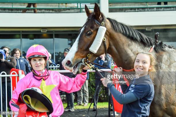 Craig Williams poses with Tan Tat Trusting after winning the Dream Thoroughbreds Plate at Ladbrokes Park Hillside Racecourse on July 26 2017 in...