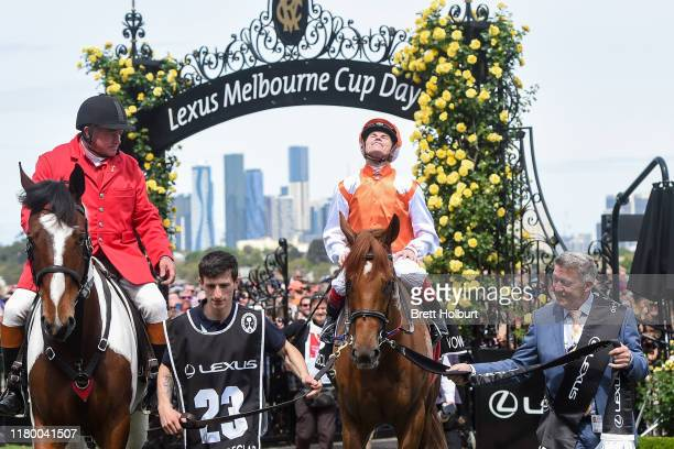 Craig Williams returns to the mounting yard on Vow And Declare after winning the Lexus Melbourne Cup at Flemington Racecourse on November 05 2019 in...