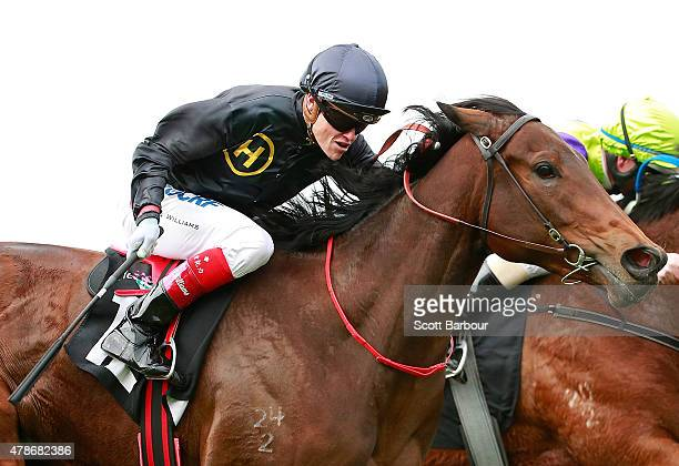 Craig Williams riding Bengal Cat wins race 1 the Murray Cox Handicap during the David Bourke Provincial Plate Day at Flemington Racecourse on June 27...