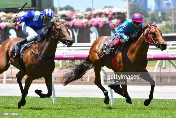 Craig Williams riding Crossing The Abbey defeats Damien Oliver riding Khulaasa in Race 1 during Melbourne Racing at Flemington Racecourse on January...