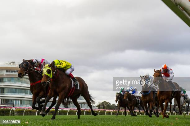 Craig Williams riding Falago defeats Dean Yendall riding Big Hammer in Race 6 Banjo Paterson Series Final during Melbourne Racing at Flemington...