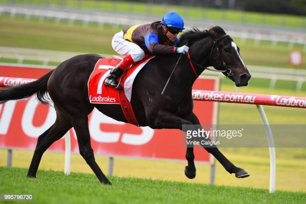 Craig Williams riding Gold Mag wins Race 3 during Melbourne Racing at Sandown Lakeside on July 11 2018 in Melbourne Australia