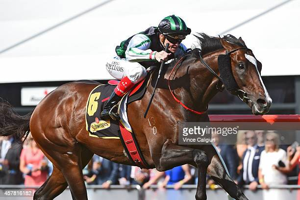 Craig Williams riding Hooked winning Race 6 the Schweppes Crystal Mile during Cox Plate Day at Moonee Valley Racecourse on October 25 2014 in...