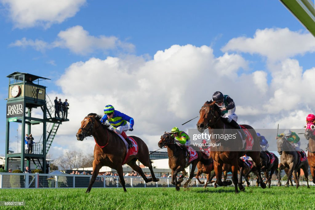 Craig williams riding Jukebox (L) dives on the line to defeat Regan Bayliss riding Plutocracy in Race 6 Vain Stakes during Melbourne Racing at Caulfield Racecourse on August 19, 2017 in Melbourne, Australia.