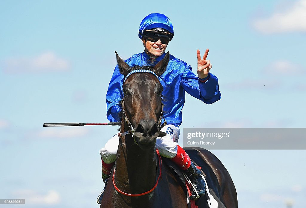 Craig Williams riding Khaki returns to scale after winning Race 6 the Dorevitch Pathology Charity Plate during Melbourne Racing at Flemington Racecourse on December 10, 2016 in Melbourne, Australia.