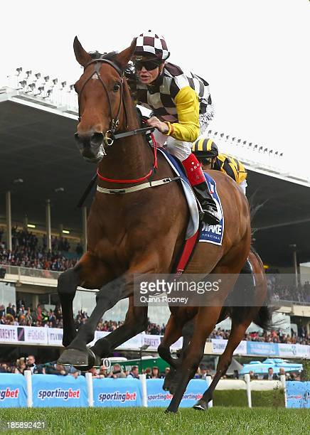 Craig Williams riding Precedence crosses the line to win the Drake International Cup during Cox Plate Day at Moonee Valley Racecourse on October 26...