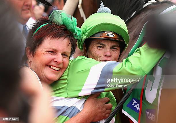 Craig Williams riding Precious Gem is hugged by trainer Gwenda Johnstone after winning race 2 the tabcomau Trophy on Melbourne Cup Day at Flemington...