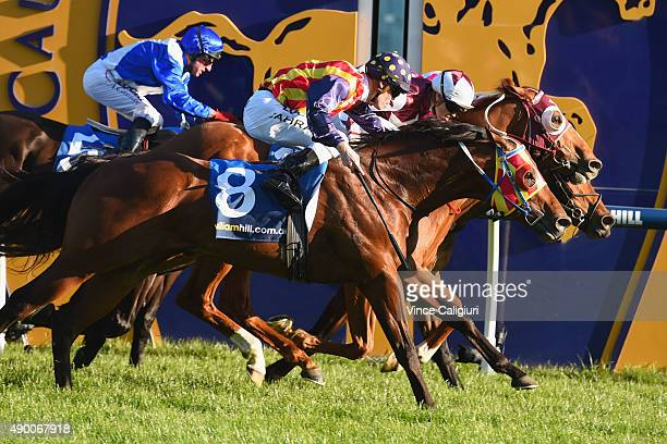 Craig Williams riding Stratum Star defeats Damien Oliver riding Disposition and Mark Zahra riding Under The Louvre in Race 8 the Sir Rupert Clarke...