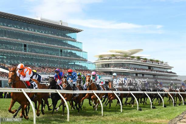Craig Williams riding Vow and Declare leads the field around the first bend in the Lexus Melbourne Cup during 2019 Melbourne Cup Day at Flemington...