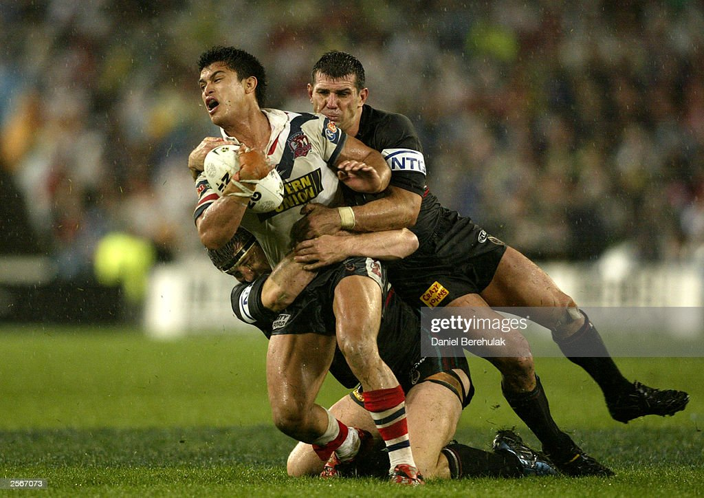 Craig Wing #9 of the Roosters is tackled by Scott Sattler (R) and Martin Lang #10 of the Panthers during the NRL Grand Final between the Sydney Roosters and the Penrith Panthers at Telstra Stadium October 5, 2003 in Sydney, Australia. Penrith won 18-6.