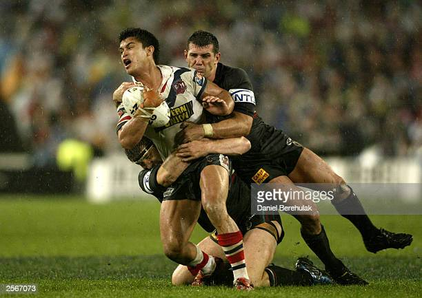 Craig Wing of the Roosters is tackled by Scott Sattler and Martin Lang of the Panthers during the NRL Grand Final between the Sydney Roosters and the...