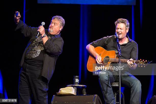 Craig Wiseman works on a selfie with Blake Shelton during the 12th Annual Stars For Second Harvest Benefit at Ryman Auditorium on June 7, 2016 in...