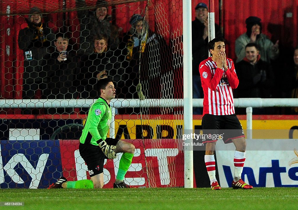 Craig Woodman of Exeter City (R) reacts after scoring an own goal during the Sky Bet League Two match between Exeter City and Cambridge United at St. James Park on February 10, 2015 in Exeter, England.
