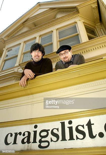 Craigslistorg founder Craig Newmark right and chief executive officer Jim Buckmaster pose outside the company s San Francisco California offices on...