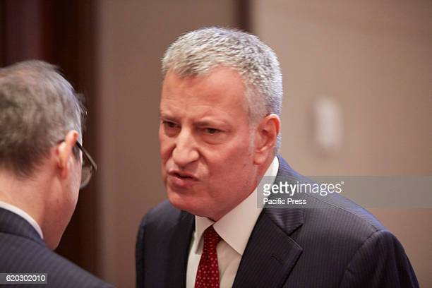 Crain's NY Getting ready for 9 Million New Yorkers Bill de Blasio 109th Mayor of New York City chats with attendee after his address