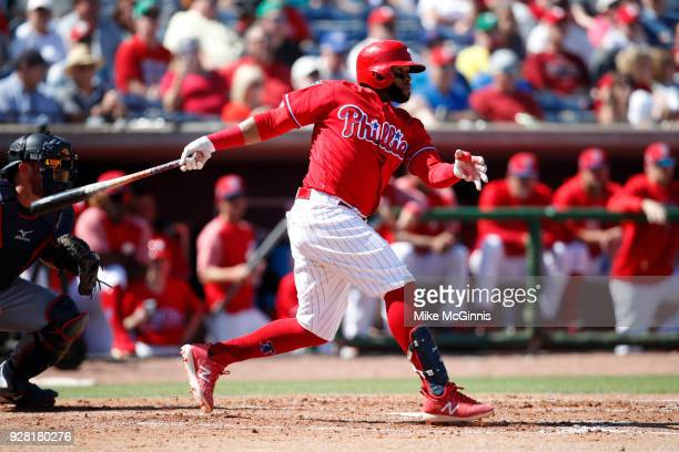 Cralos Santana of the Philadelphia Phillies make some contact at the plate during the Spring Training game against the Minnesota Twins at Spectrum...