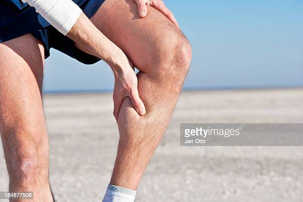 cramp in calf - leg stock pictures, royalty-free photos & images