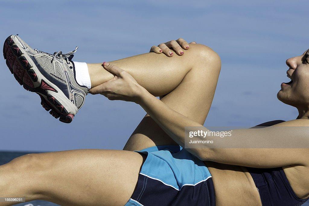 cramp in her calf : Stock Photo