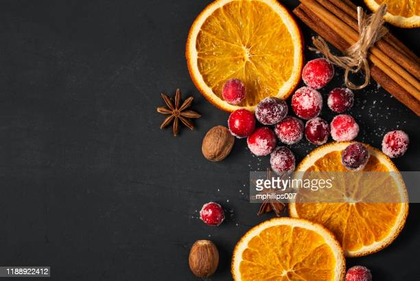 cranberries, dried oranges, and spice for the holidays - cranberry stock pictures, royalty-free photos & images