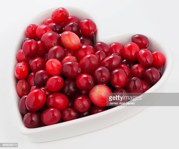 Cranberries in heart-shaped bowl