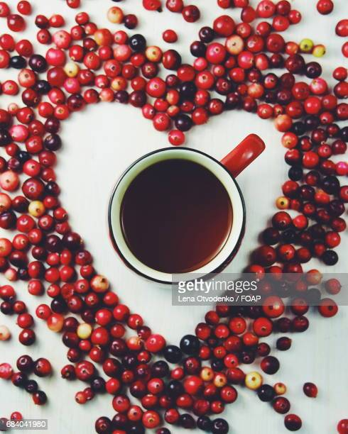 Cranberries in the shape of a heart with tea
