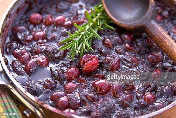 cranberry sauce cooking for christmas or thanksgiving - cranberry sauce stock photos and pictures