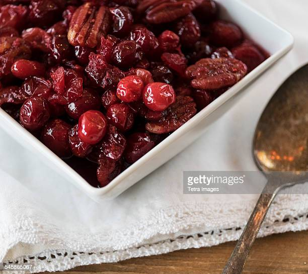 cranberry sauce on white napkin - cranberry sauce stock photos and pictures
