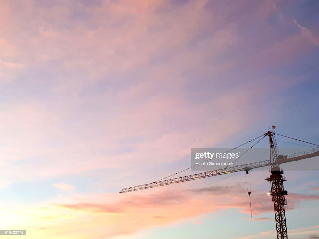 Crane against blue sky at dusk in Tokyo, Japan : Stock Photo