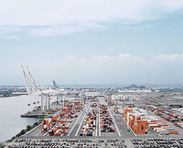 Crane and cargo containers on pier, elevated view