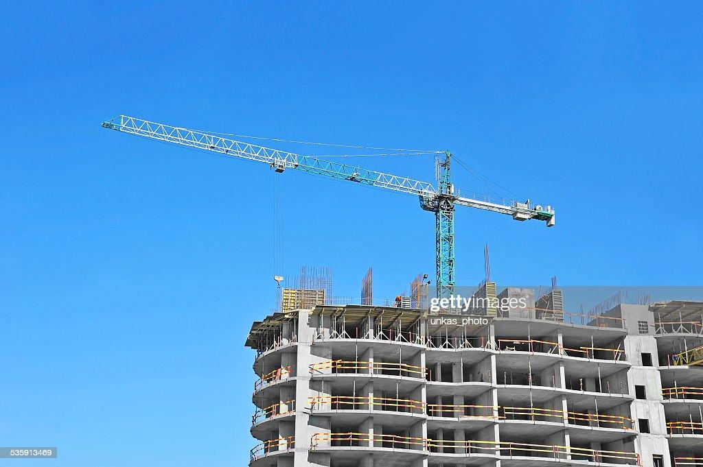 Guindaste e construção site : Foto de stock