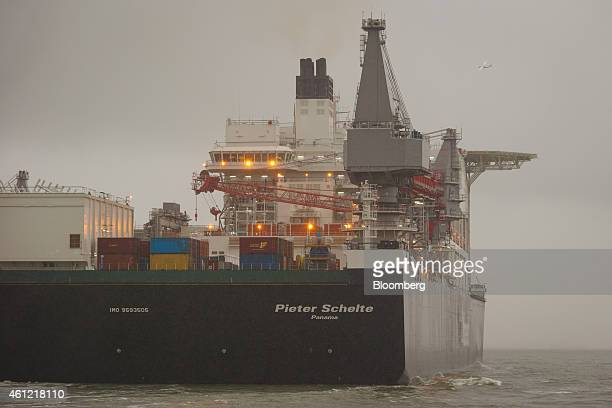 A crane and shipping containers sit aboard the Pieter Schelte the world's largest oil rig platform installation/decommissioning and pipelaying vessel...