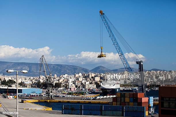 A crane and stacked containers in COSCO owned dockyard in Piraeus on March 4 2015 China Ocean Shipping Company known as COSCO is the company in...