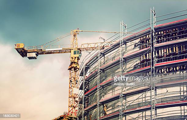 crane at a construction site - crane construction machinery stock pictures, royalty-free photos & images