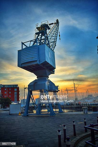 crane at commercial dock at dusk - portsmouth england stock pictures, royalty-free photos & images