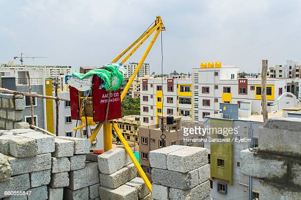 Crane By Building