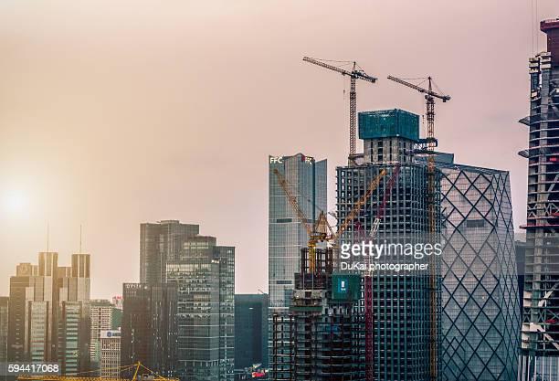 Crane by urban skyscraper in beijing
