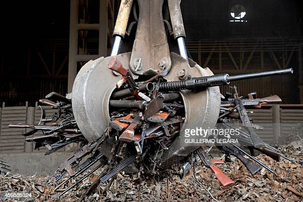 A crane carry part of 9517 weapons seized from the FARC and ELN guerrillas criminal gangs and organized crime before being melted in furnaces of the...