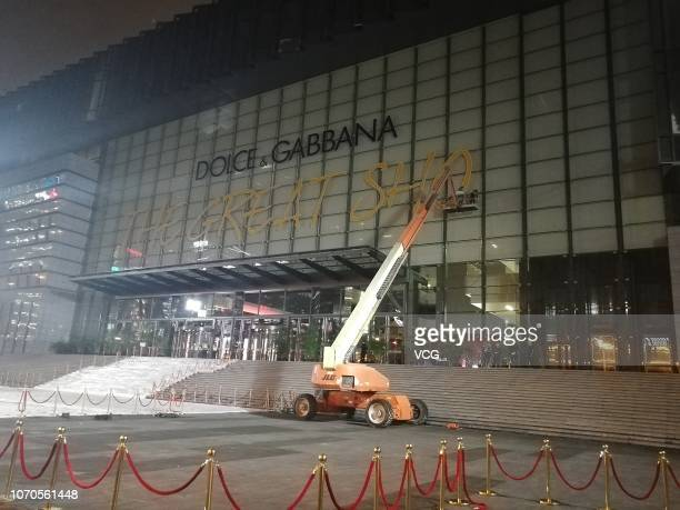 A crane demolishes the Dolce Gabbana logo as the Dolce Gabbana Great Show was cancelled tonight on November 21 2018 in Shanghai China Many Chinese...