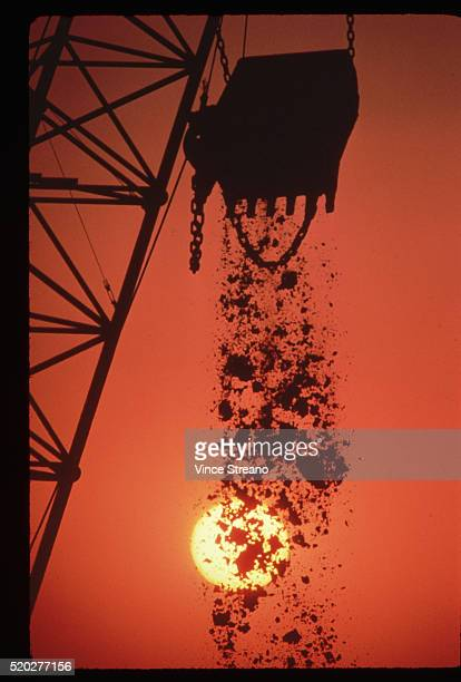 Crane Dumping Coal at Sunset