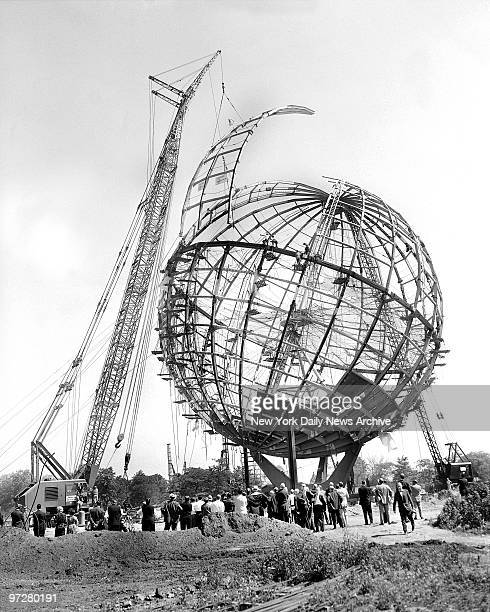 Crane eases last segment of the Unisphere into place to complete structure which will serve as symbol of the World's Fair in Flushing Meadow....