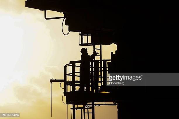 A crane engineer climbs a ladder on the Armada gas condensate platform operated by BG Group Plc in the North Sea off the coast of Aberdeen UK on...