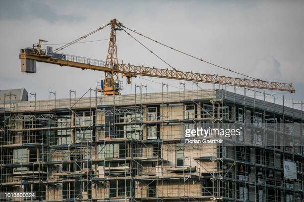 A crane for house construction are pictured on August 08 2018 in Berlin Germany