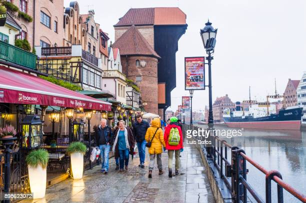 crane gate and restaurants at the gdansk waterfront - motlawa river stock pictures, royalty-free photos & images