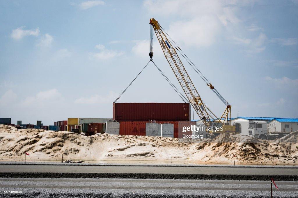 A crane hoists a container at the under-construction Dangote    News